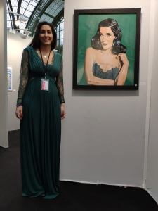 Posing in my viridian dress next to my green painting of Dita von Teese